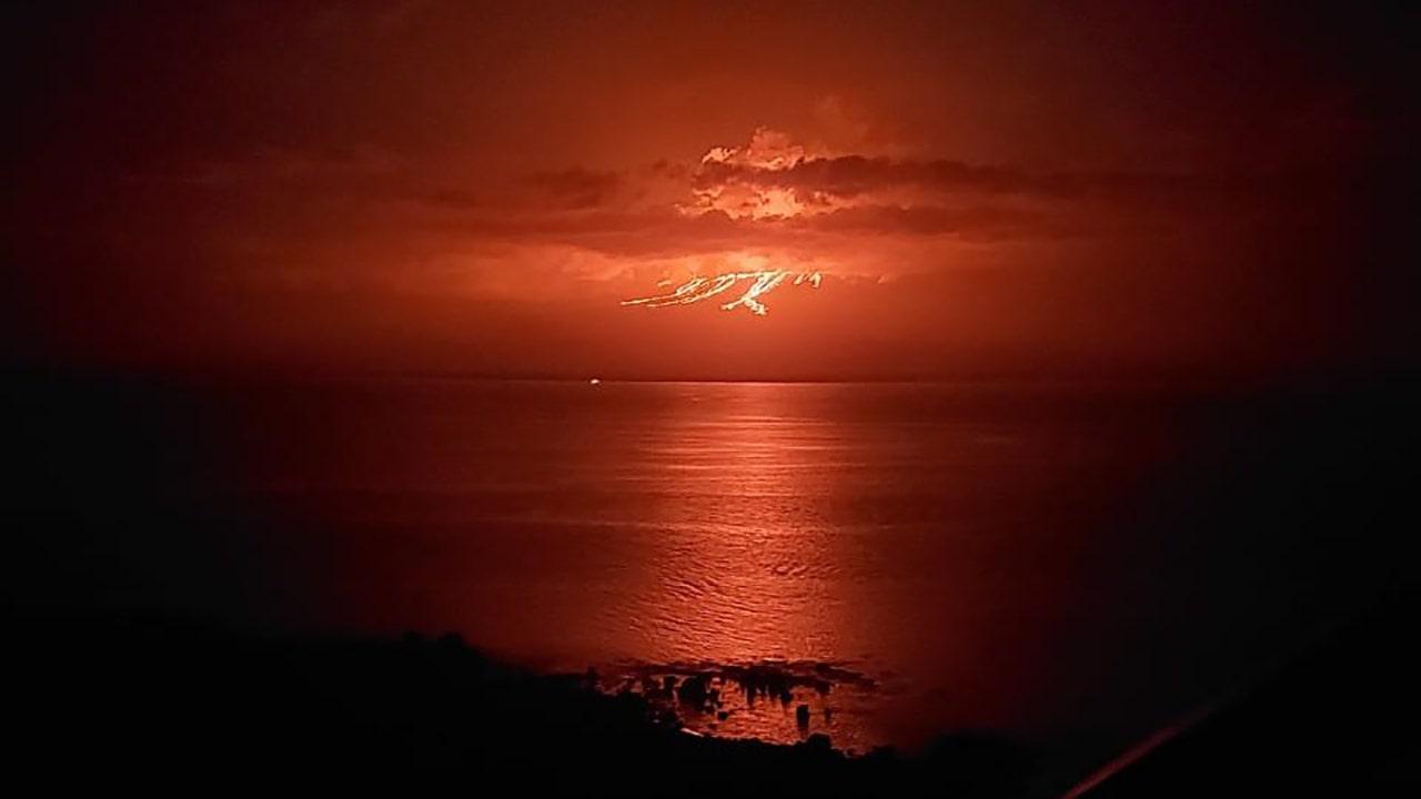 Galapagos volcano eruption spews lava on uninhabited island, photos show