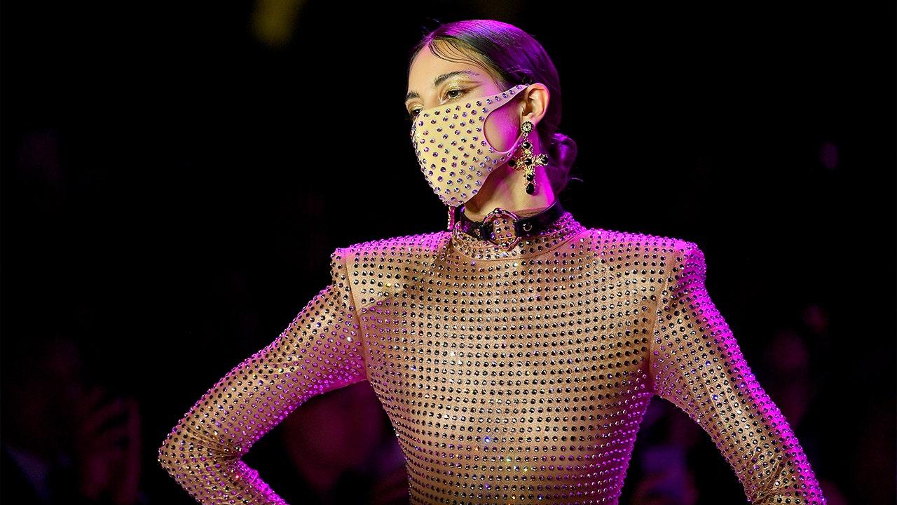 Face masks are must-have accessory of London fashion week amid coronavirus panic