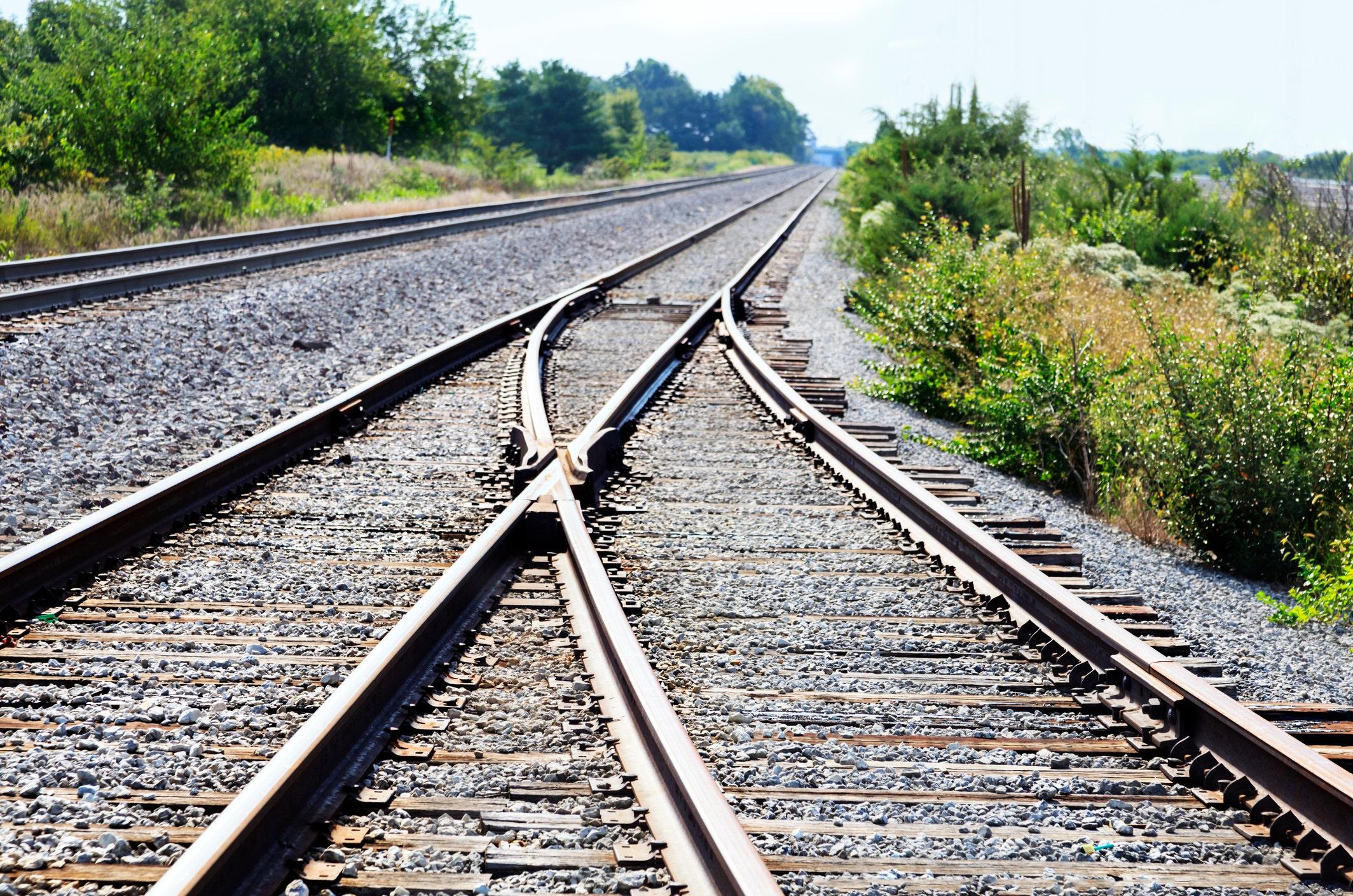 Family taking photos on railroad tracks narrowly escapes train in terrifying video - fox