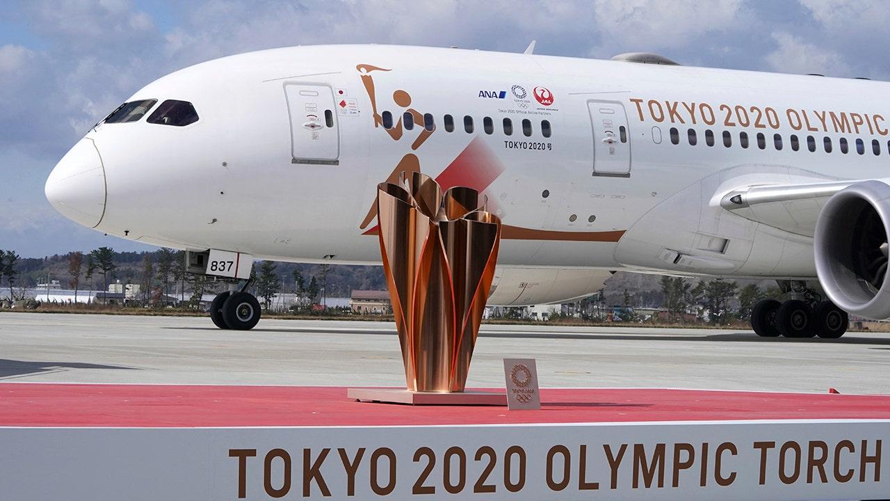 Η ολυμπιακή φλόγα εδάφη στην Ιαπωνία ως αμφιβολίες αυξηθεί με την πάροδο του Tokyo Games