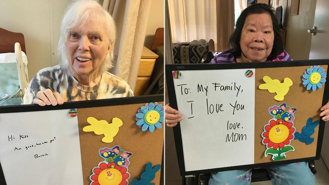 Washington Pflegeheim-Bewohner heben Spirituosen während der coronavirus-lockdown-mit persönlichen Notizen Familien