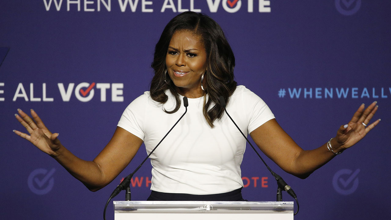 Michelle Obama warns that 'our democracy remains under attack' by state officials