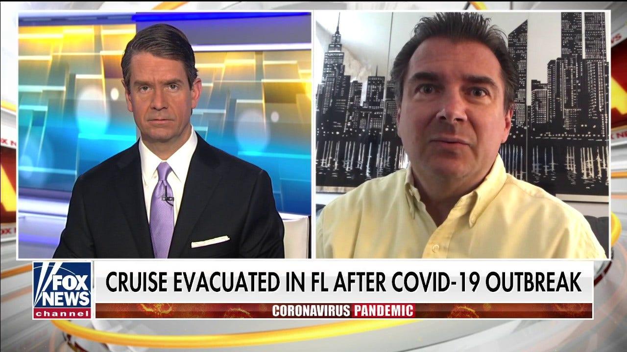 Holland America cruise penumpang mengibarkan bendera merah tentang mendarat proses di Florida selama coronavirus