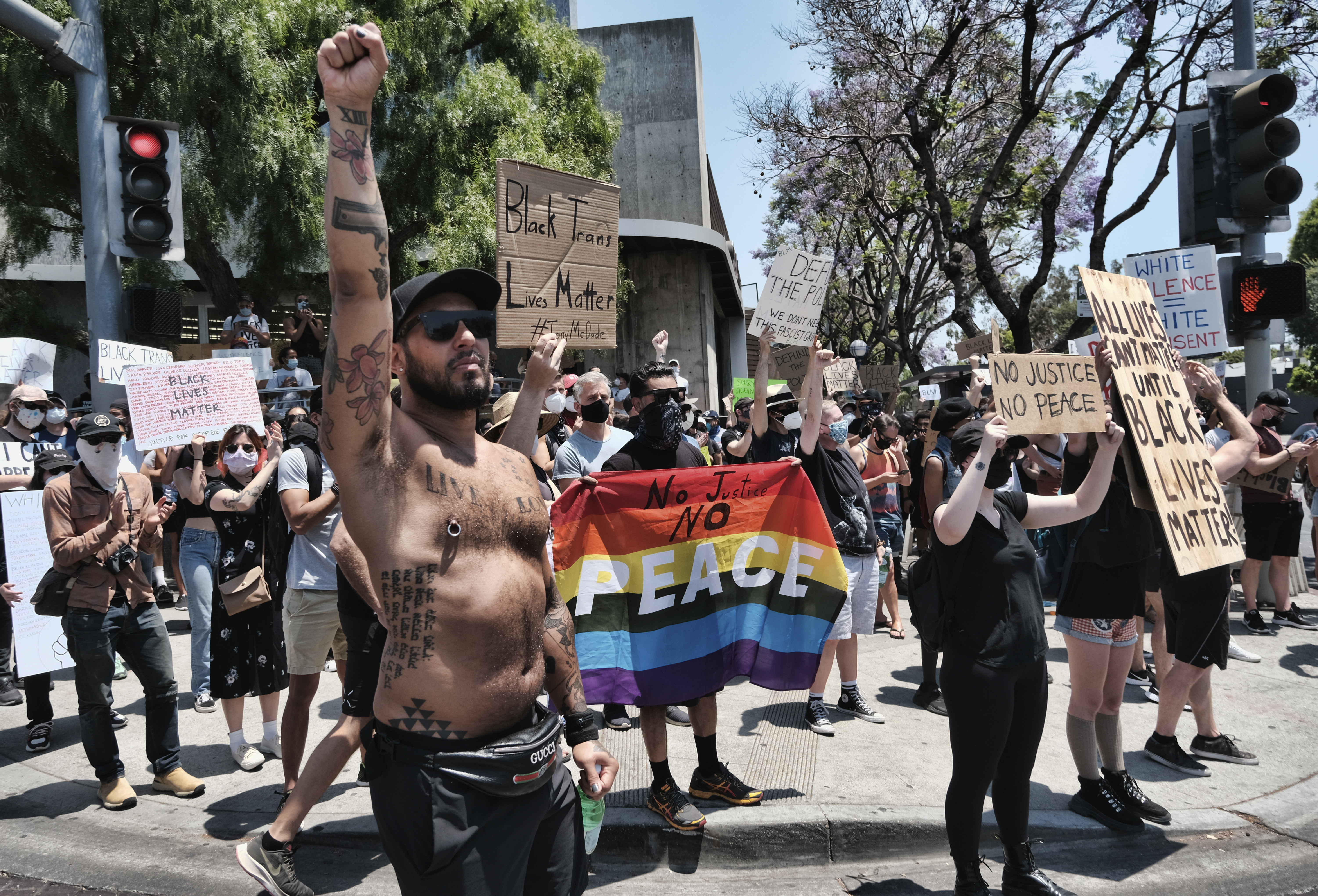 Newport Beach protesters scatter as car heads toward them; suspect in custody: report