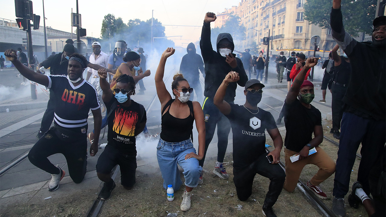 Paris police unleash tear gas as rioters spark fires, hurl debris