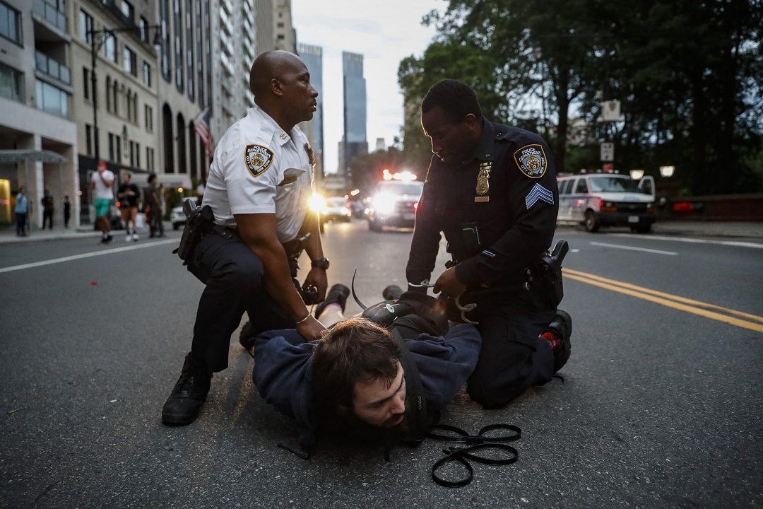 NYPD confronts George Floyd demonstrators as curfew takes effect
