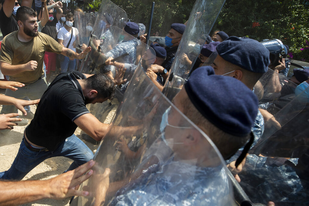 Lebanese authorities fire tear gas as protesters chant...