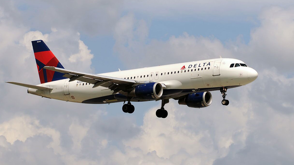 Delta flight returns to gate after woman refuses to wear mask  image