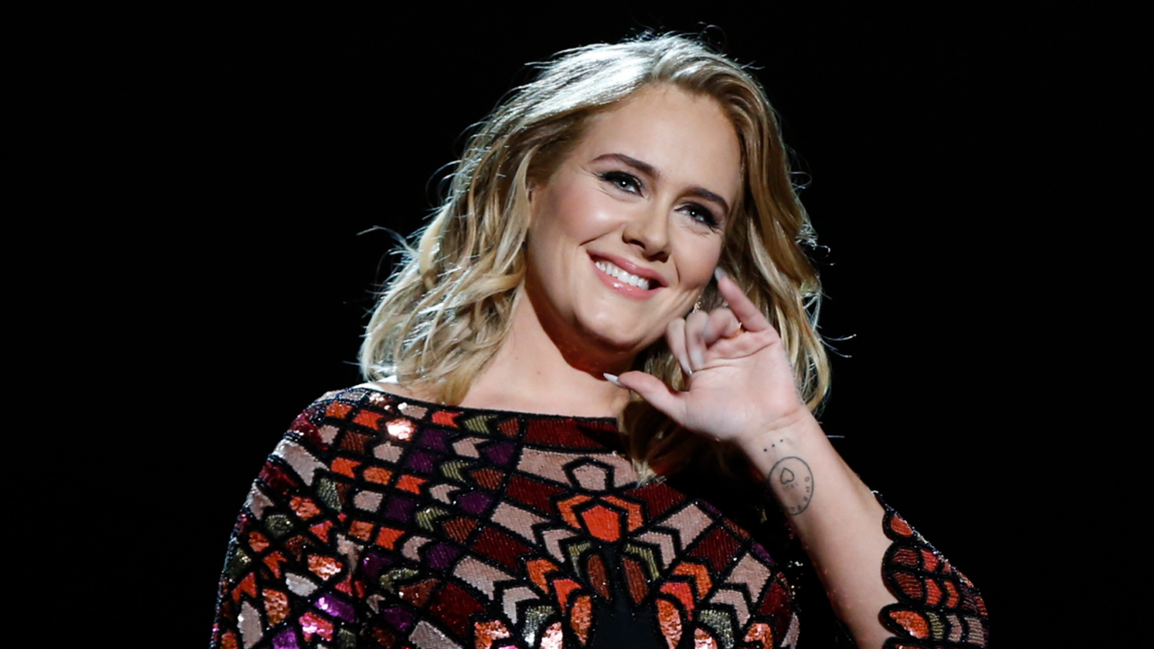 Adele hosts 'SNL,' jokes about weight loss and talks about upcoming album