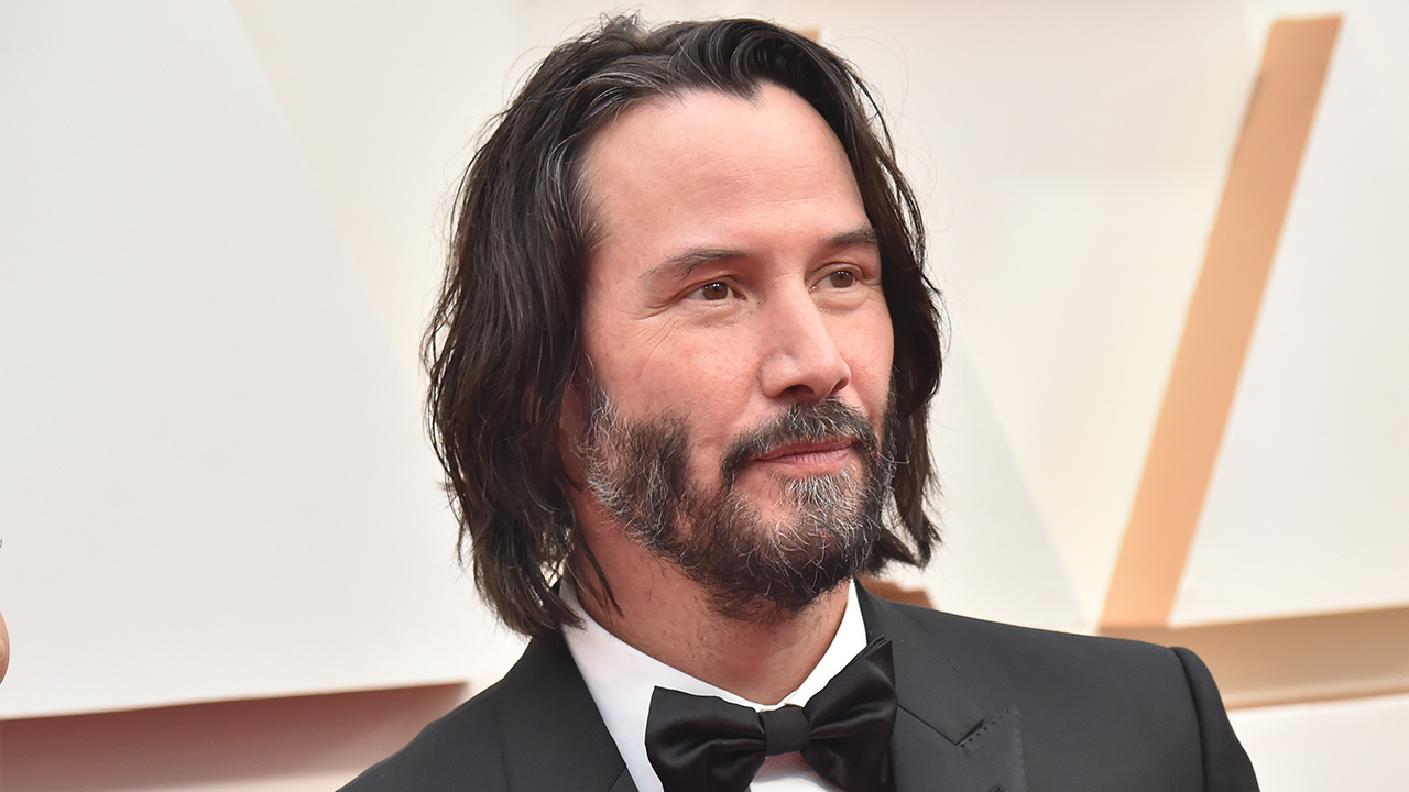 Keanu Reeves gets a new haircut while filming 'The Matrix 4'