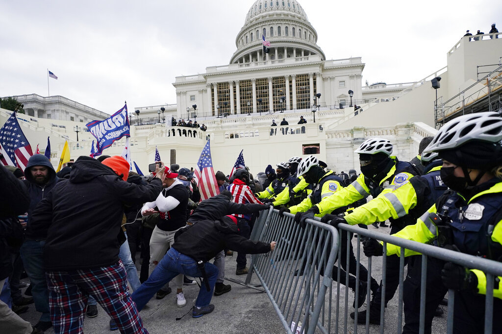 Capitol riots Live Updates: Left-wing activist charged still active on Twitter, despite Trump ban