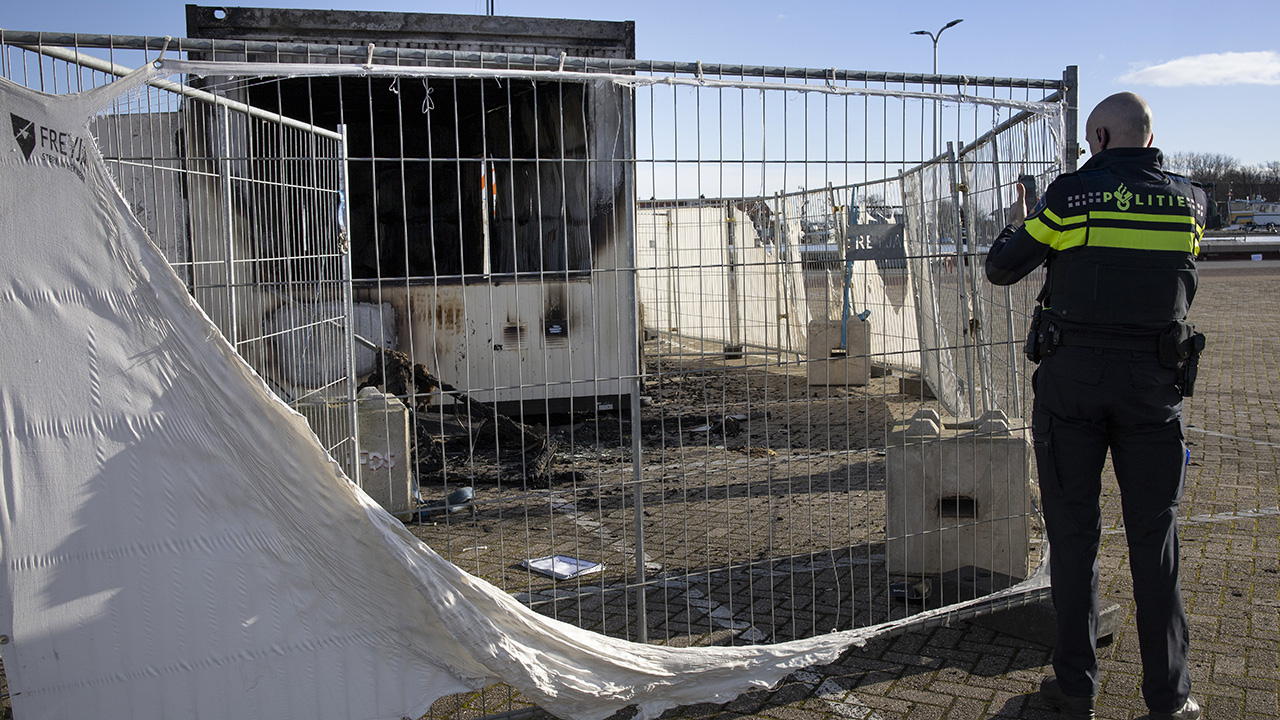Rioting youths in Dutch village torch virus testing center