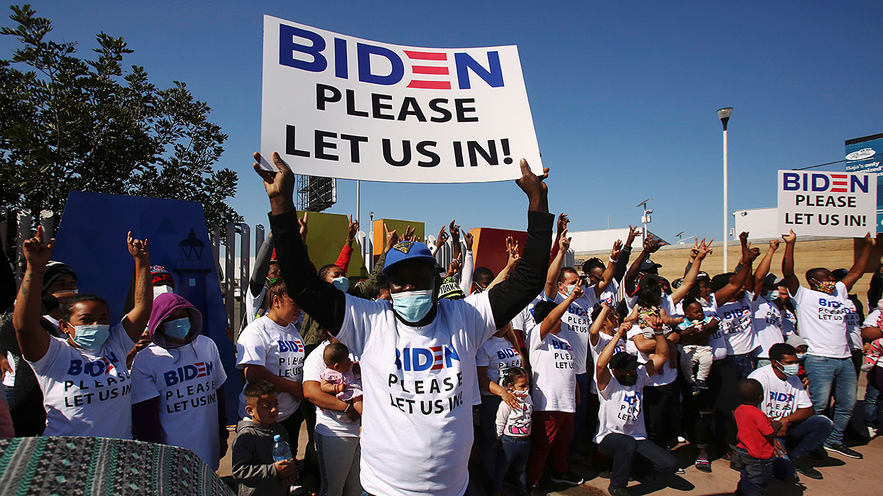 Migrants wear Biden T-shirts at US-Mexico border, demand clearer policies