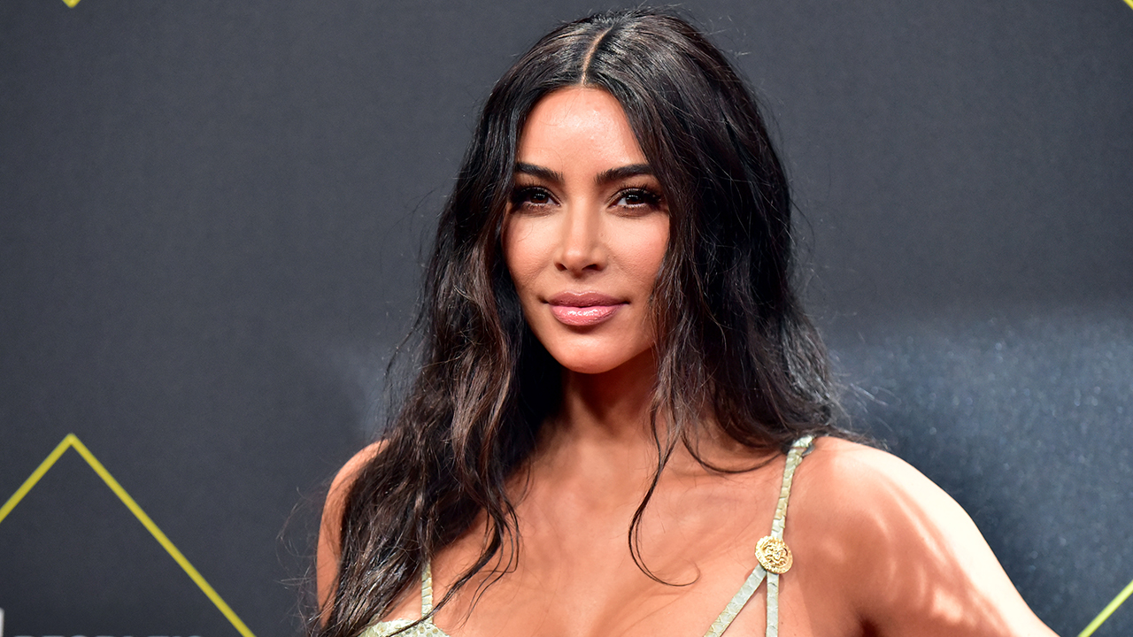 Kim Kardashian shows off figure, platinum blonde hair while working out in revealing swimsuit - Fox News