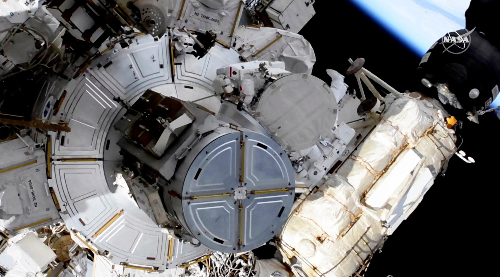 Spacewalking astronauts boosting station's solar power