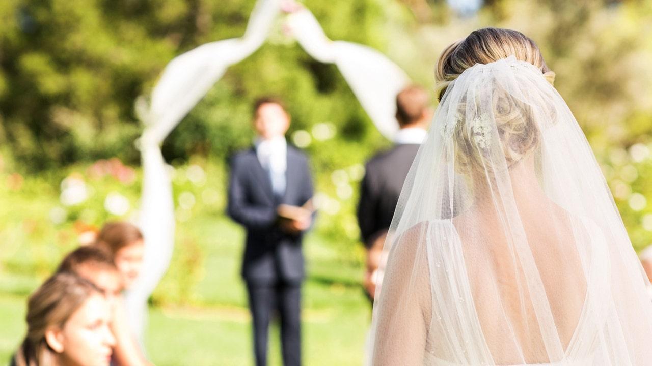 Groom checks phone while bride walks down aisle, viral TikTok shows