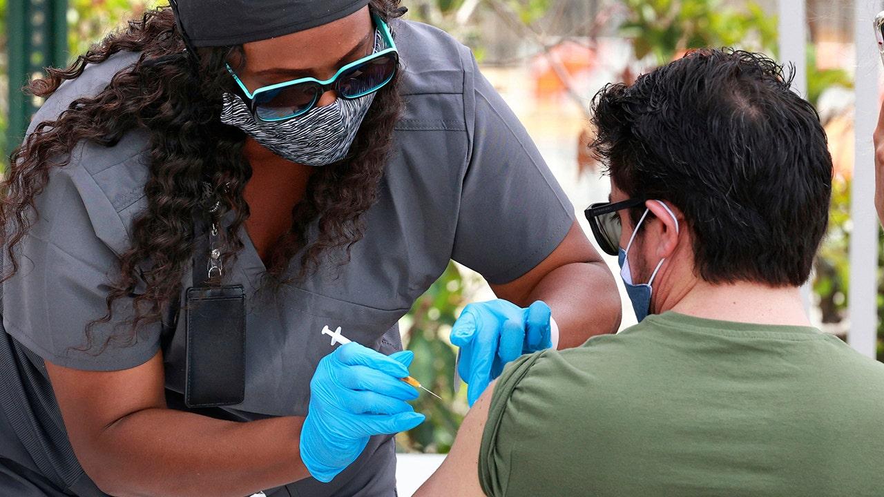 US hits encouraging milestones on virus deaths and shots