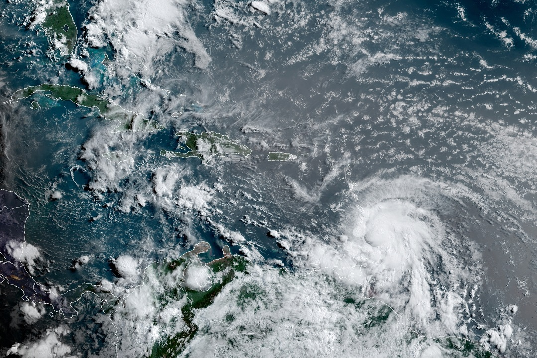 Elsa strengthens to hurricane status, further complicating condo collapse search efforts