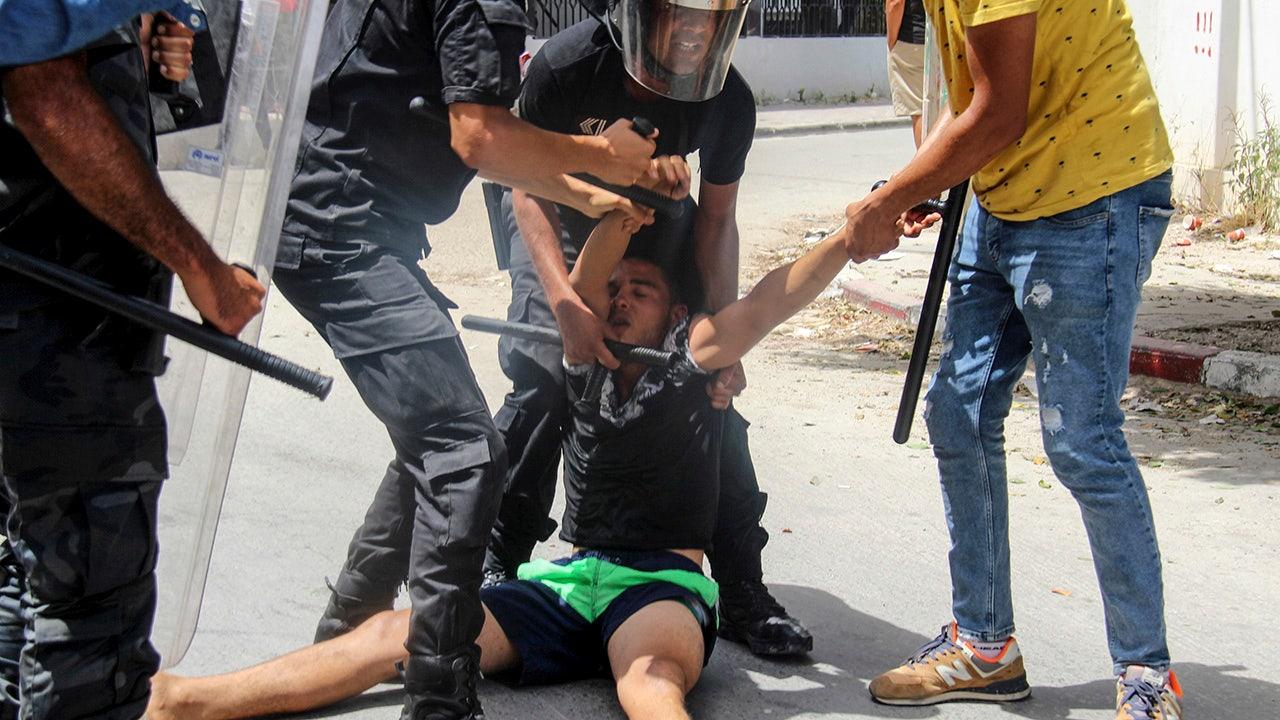 Tunisian president fires premier after violent protests