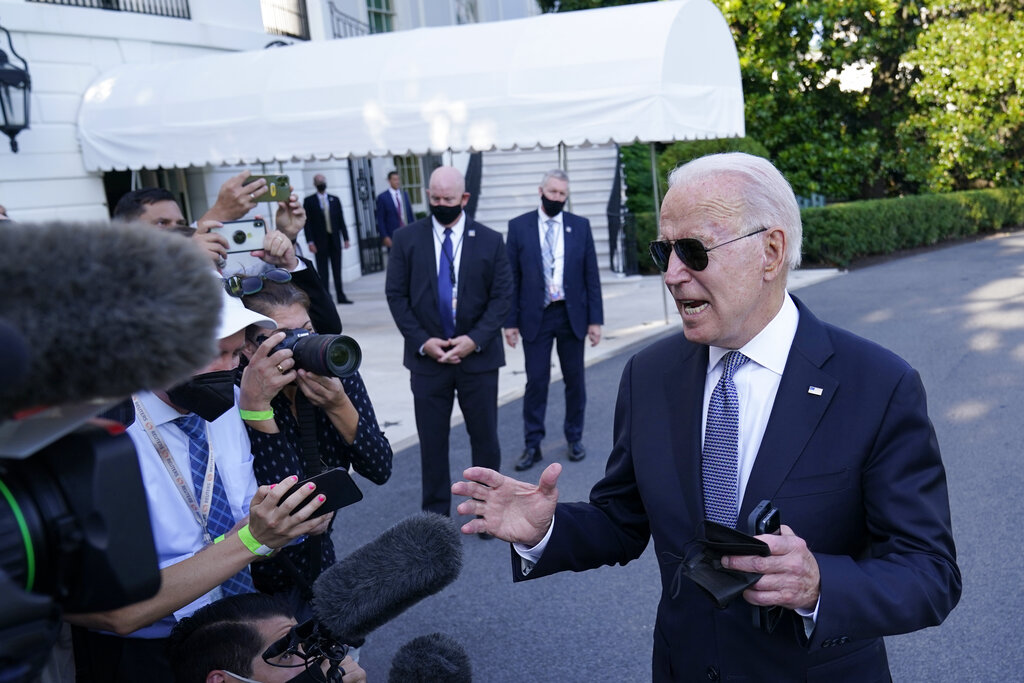Biden says Americans should expect more COVID restrictions