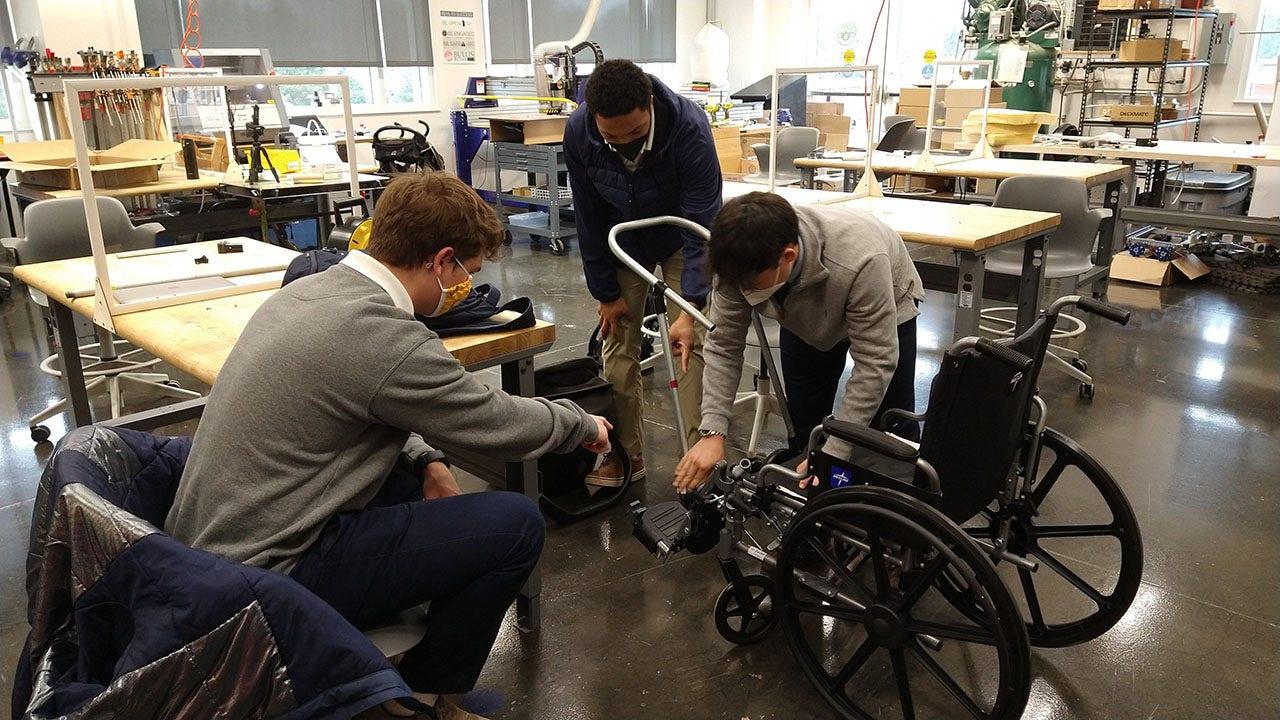 High school students build wheelchair stroller to help father walk his newborn