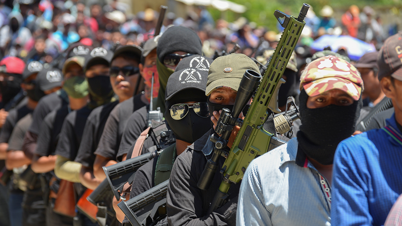 Mexico vigilante group abducts 21, burns homes in raid on town, officials say
