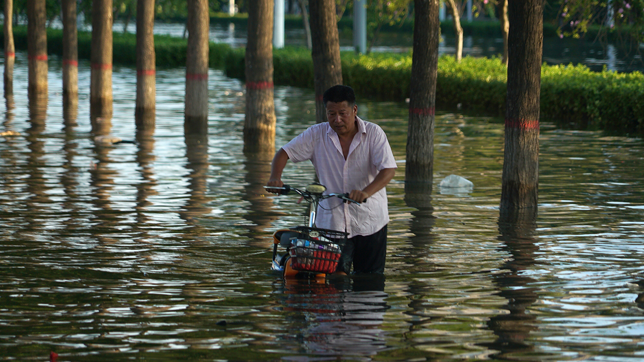 Death toll jumps to more than 300 in recent China flooding
