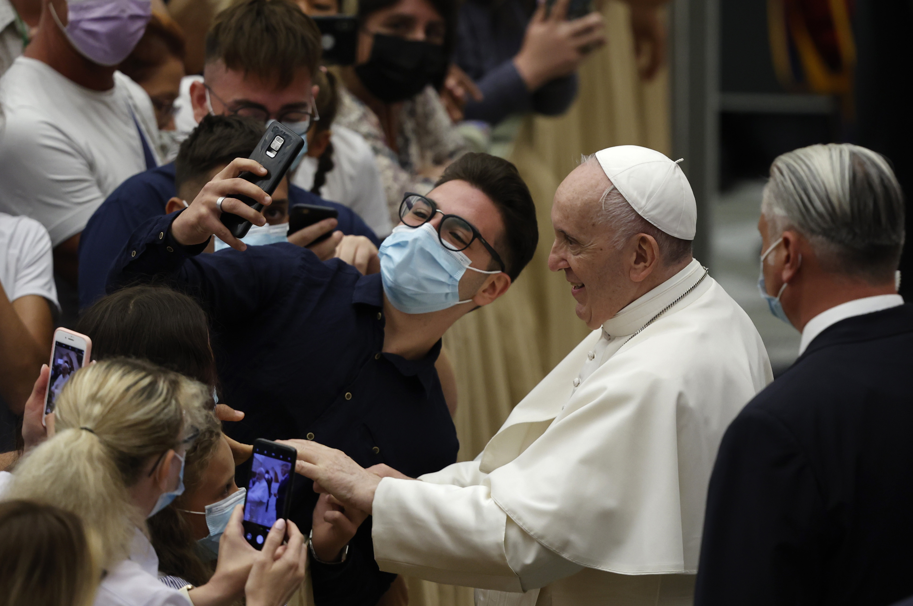 Pope resumes public audiences a month after major surgery