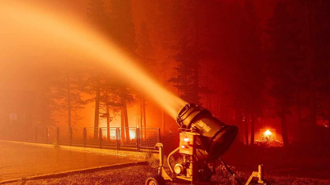 California firefighters use snow machines to fight Caldor Fire at Tahoe resort