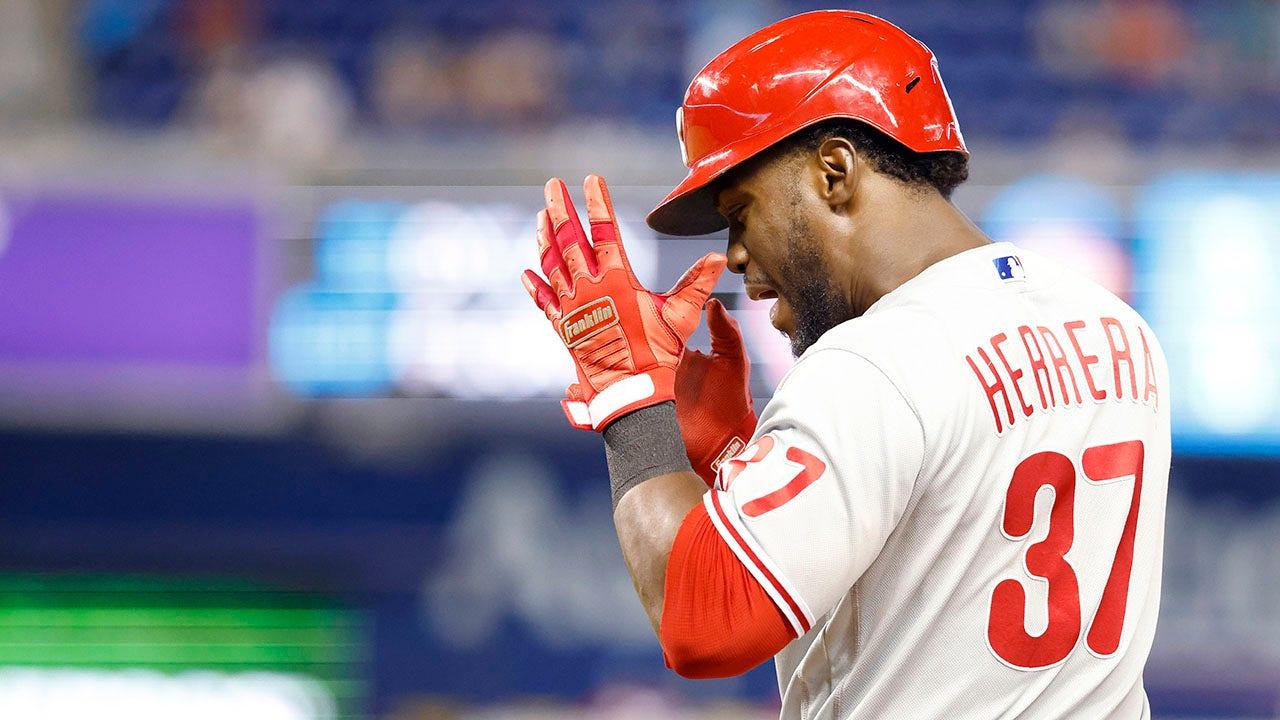 Herrera hits RBI single in 10th, Phils avoid sweep in Miami