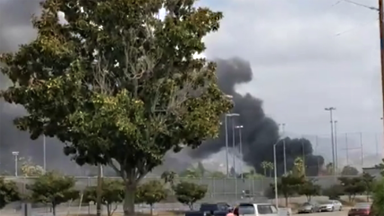 California plane crash: Dramatic video shows bystanders rescuing woman from burning home