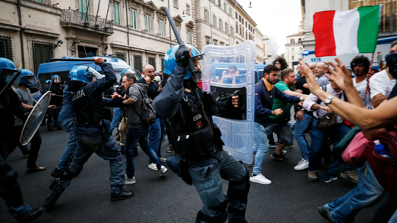 Rome protesters clash with police as thousands pack the streets in opposition to COVID vaccine rule