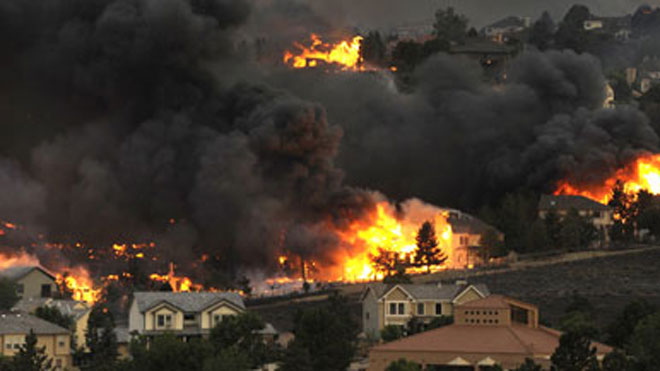 Tens of thousands flee their homes as Colorado wildfire grows ...