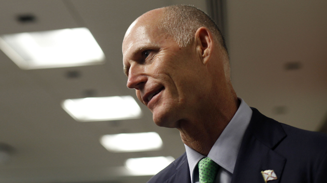 FILE: Florida governor Rick Scott gave out an incorrect phone number to ...