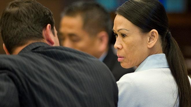 April 17: Catherine Kieu sits next to her attorney. Kieu is charged ...