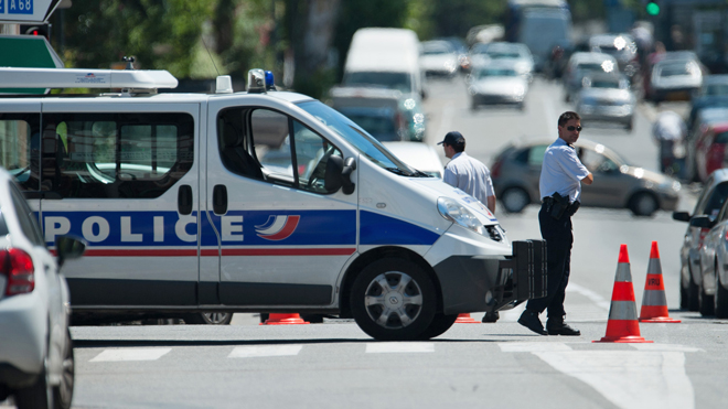 June 20, 2012: Police officers secure the area after a gunman took four people hostage in a bank in the southern French city of Toulouse and fired a shot, police said.  Read more: http://www.foxnews.com/world/2012/06/20/man-claiming-al-qaeda-links-takes-hostages-at-french-bank/#ixzz1yMVwKOx9