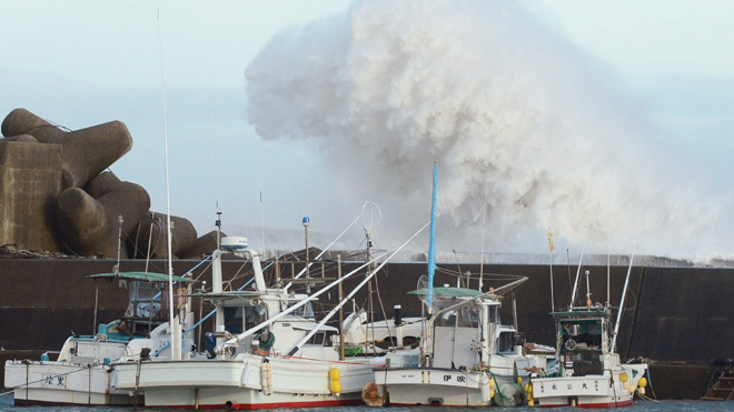 High waves hit a breakwater in Kihocho, Mie prefecture, western Japan.  Read more: http://www.foxnews.com/world/2012/09/30/powerful-typhoon-injures-dozens-as-it-heads-to-tokyo/#ixzz282yS455w