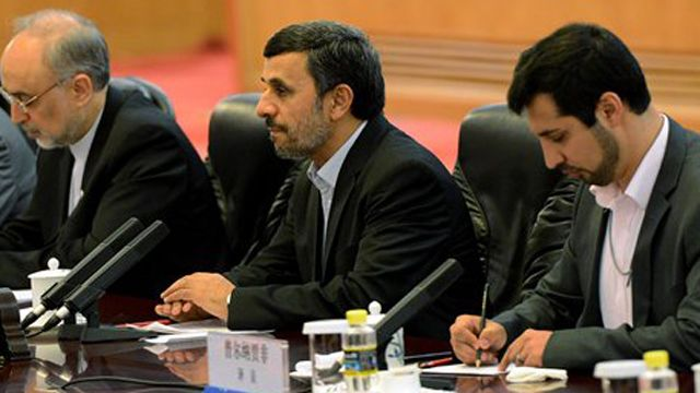 Iran feels economic pinch as it warns Moscow nuclear talks could stall.